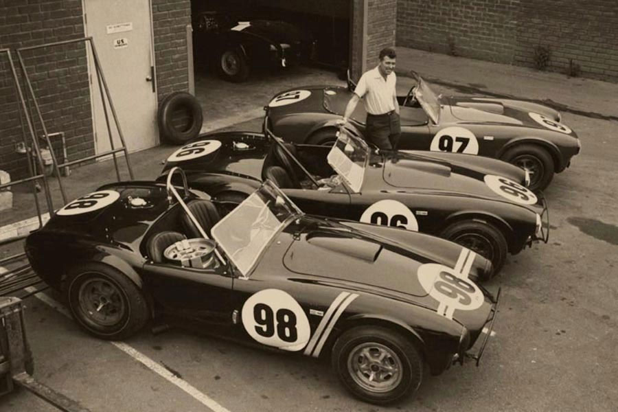 Carroll Shelby standing with his creations